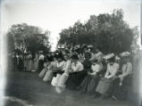 Spectators on the sidelines of a game between Pomona College class of 1901 and class of 1904