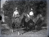 Two women horseback riding