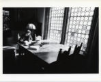 Student in Holbein Room of Denison Library, Scripps College