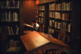 Student studying at Denison Library, Scripps College