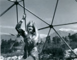 Student in geodesic dome, Pitzer College