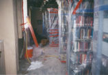 Books wrapped in plastic during renovation of Honnold/Mudd Library
