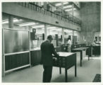 Browsing the card catalog at Seeley W. Mudd Library