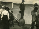 Man stands on barrel, Pomona College