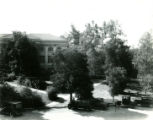 Carnegie Hall Library with parked cars, Pomona College