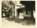 Women outside a house, Pomona College