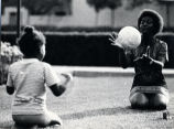 Woman and young girl playing catch, Pitzer College