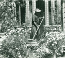Sprague Library with gardener, Harvey Mudd College