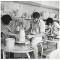 Henry Takemoto and student with pottery wheel, Scripps College