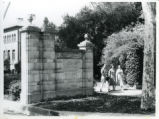 Pomona College gates, students walking, Pomon College