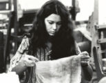 Textiles student with cloth, Scripps College