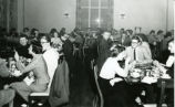 Students eating and smoking, dining hall, Pomona College