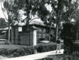 Pomona College gates, man walking, Pomona College