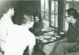Students playing card game, Scripps College