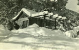 Fraternity cabin with snow, Pomona College