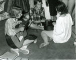 Women playing musical instruments, dormitory room, Pomona College