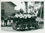 Brass band in antique car, Harvey Mudd College