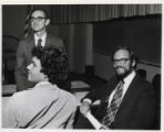 C. Fred Bergsten sitting with two men, Claremont McKenna College