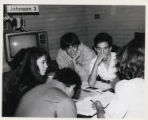 Students sitting around a table, Claremont McKenna College