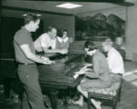 Two students playing the piano, Claremont McKenna College