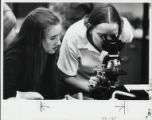 Women working with a microscope, Scripps College