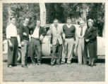 Alumni standing next to a car, Claremont McKenna College
