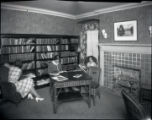 Women reading, bookshelf, Pomona College