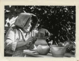 Woman works on pottery, Scripps College
