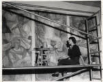 Woman painting mural, Scripps College