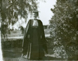 Student in cap and gown, Pomona College