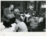 Dr. Merlan hands out a test, Scripps College