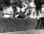 Dawn Gardner jumping over a hedge, Scripps Campus