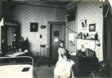 Woman seated at a desk, dormitory room, Pomona College