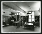 Three students reading in the new Drake Wing of Denison Library, Scripps College