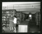 Dorothy Drake and a student read together in Drake Wing of Denison Library, Scripps College