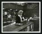 Judy Harvey Sahak reading in Denison Library's Rare Book Room, Scripps College