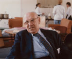 Peter Drucker sitting in a chair