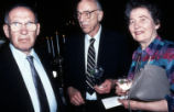 Peter Drucker standing next to two individuals