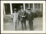 Frank Polkinghorn standing between two men, 1950-09-30