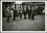 Frank and Priscilla Polkinghorn standing with six people