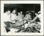 Men and women standing in line for food, 1948-08-25