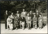 Charles Protzman and his wife with a group of people and Bunzaemon Inoue
