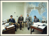 Four men in a room with a map on the wall, 1969-07-24