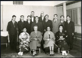 Charles Protzman and his wife with a group of people