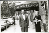 Charles Protzman and his wife standing in front of a building, 1961-05