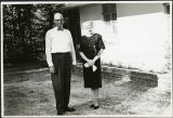 Charles Protzman and his wife standing in a yard, 1961-05