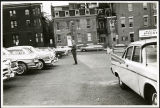 Charles Protzman standing in a parking lot, 1961-05