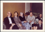 Charles Protzman and his wife seated with people, 1960-06
