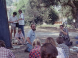 Instructor teaching a class under a tree