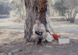 Larry Oglesby teaching under a tree